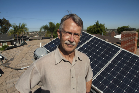 Bill Powers atop of off-grid, solar-powered home in San Diego.